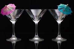 3 пустых стекла шампанского с бумажными зонтиками Стоковое фото RF