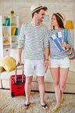 Путешественники с билетами и чемоданом Стоковые Изображения RF
