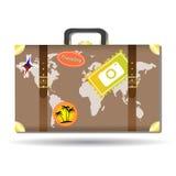 Путешествовать сумка с стикерами и картой мира Стоковое фото RF