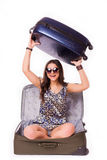 Путешествуйте концепция каникул предназначенная для подростков с полным багажом на белизне Стоковое фото RF