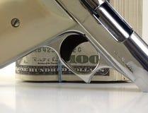 Пушка и деньги Стоковое фото RF