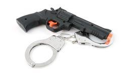 пушка надевает наручники игрушка игры Стоковые Фото