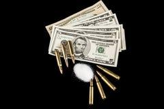 Пули на долларах Стоковое фото RF
