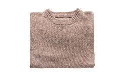 Пуловер сложенный бежом Стоковые Фото