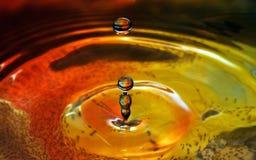 Пульсации и падения воды Стоковая Фотография
