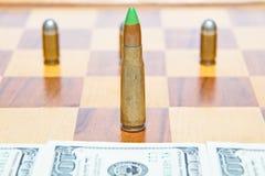 Пуля вместо шахматной фигуры Концепция военной власти Стоковое фото RF