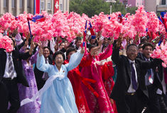 ПХЕНЬЯН, СЕВЕРНАЯ КОРЕЯ – 27-ОЕ ИЮЛЯ 2012: Пивничнокорейськие люди Стоковая Фотография