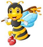 Пчела шаржа держа ветроуловитель меда Стоковая Фотография