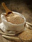 Пшеница grits мешок Стоковые Изображения