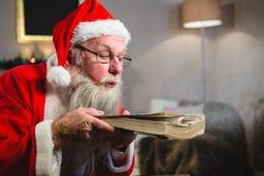 Пылевая поземка Санта Клауса от книги Стоковое Изображение RF