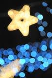 пыль рождества освещает звезду Стоковое Изображение RF
