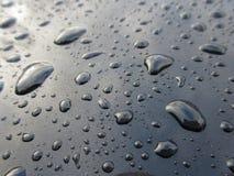 Пятна воды на черной краске Стоковое Изображение