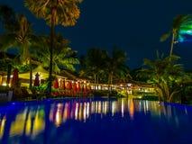 Плавательный бассеин на ноче Стоковые Фотографии RF
