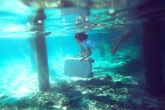 Плавать в море Стоковое фото RF