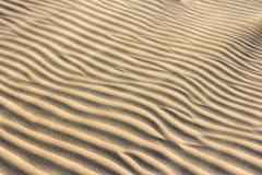 Текстура песка с плавая песком поперек Стоковая Фотография