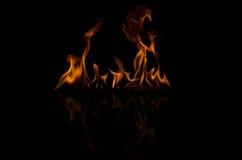 Пламена пожара на черной предпосылке Стоковое фото RF