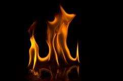 Пламена пожара на черной предпосылке Стоковые Изображения RF