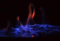 Пламенеющая предпосылка черноты спирта стоковые фото