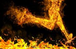Пламенистый идущий человек на черной предпосылке Стоковое фото RF
