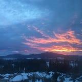 Пламенистый снежный заход солнца Стоковая Фотография RF