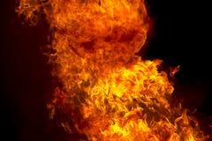 Пламя красного огня на черной предпосылке Стоковые Фотографии RF