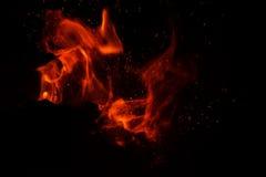 Пламя огня на черной предпосылке Стоковые Изображения RF