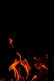 Пламя огня на черной предпосылке Стоковые Фото