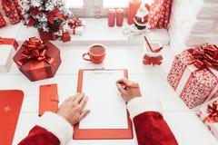 Планирование Санты для рождества Стоковые Фото