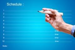 План-график сочинительства бизнесмена с временем Стоковое Фото