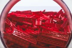 Пластичная игрушка кирпича в красном цвете Стоковая Фотография
