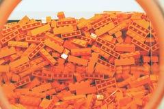 Пластичная игрушка кирпича в оранжевом цвете Стоковые Фото