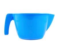 Пластичная измеряя изолированная чашка Стоковые Фото