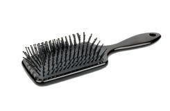 Пластичная щетка для волос Стоковое Фото