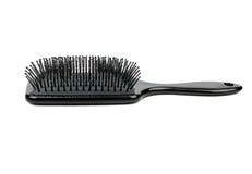 Пластичная щетка для волос Стоковые Фото