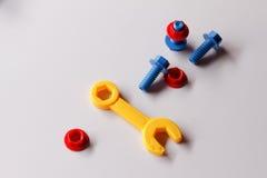 Пластичные игрушки, винты и гайки Стоковое Изображение