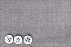 Пластичные кнопки на ткани Стоковые Фотографии RF