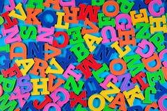 Пластичные красочные письма алфавита на сини Стоковое фото RF