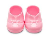 Пластичные розовые ботинки младенца Стоковое Фото