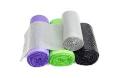 Пластичные сумки отброса в кренах различных размеров и цветов Стоковое Изображение