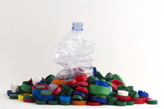 Пластичные штепсельные вилки и бутылка Стоковые Изображения RF
