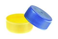 2 пластичных крышки изолированной на белизне Стоковое Изображение