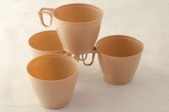 4 пластичных чашки cofffee Стоковая Фотография