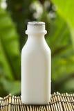 пластмасса парного молока бутылки Стоковая Фотография RF