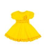 Платье желтого цвета младенца изолированное на белой предпосылке стоковые фото