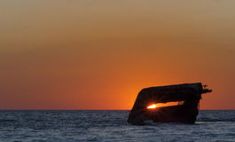 плаща-накидк может заход солнца Стоковое Изображение