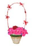 Плетеная корзина с искусственными цветками Стоковая Фотография