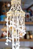 Плетеное белое украшение на двери. Стоковая Фотография RF