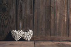 Плетеные сердца на древесине Стоковое Изображение