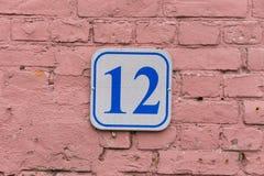 плита 12 на стене Стоковая Фотография