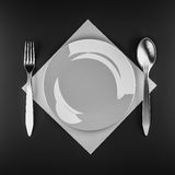Плита на темной таблице Стоковая Фотография RF